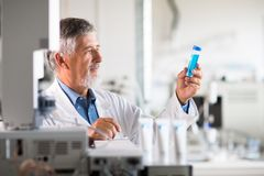 Senior chemistry professor/doctor carrying out research experiments Royalty Free Stock Image