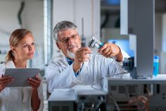 Senior chemistry professor/doctor in a lab Stock Images