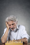 Senior chess player Stock Photo
