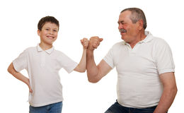 Senior and children show muscle hands stock photo