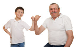 Senior and children show muscle hands Stock Images
