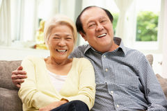 Senior Chinese Couple Relaxing On Sofa At Home Royalty Free Stock Image