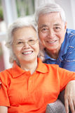 Senior Chinese Couple Relaxing On Sofa At Home Stock Images