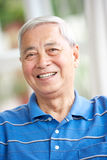 Senior Chinese Man Relaxing On Sofa At Home Stock Image