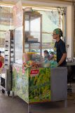 Senior Chinese woman in food stall Royalty Free Stock Photography