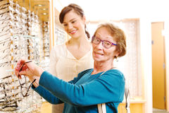 Senior choosing new frames for glasses Royalty Free Stock Images