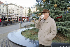 Senior on the christmas market Royalty Free Stock Image