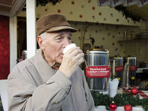 Senior on the christmas market Stock Photography