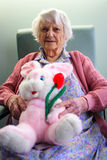 Senior citizen. Beautiful 93yr old Senior citizen holding stuffed easter bunny royalty free stock images