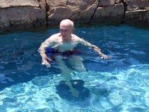Senior citizen 4. Senior citizen swimming in a gorgeous rock pool Royalty Free Stock Photos
