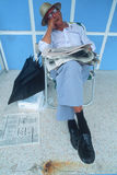 A senior citizen asleep in a lawn chair, Stock Photo