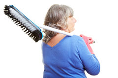 Senior citizen carrying scrubber Stock Images