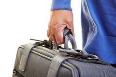 Senior citizen carrying suitcase stock photos