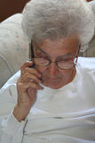 Senior Citizen And Cell Phone. Senior citizen woman talking on a cell phone stock photo