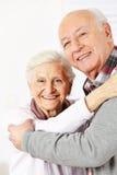 Senior citizen couple dancing. Happy senior citizen couple dancing together and smiling stock photography