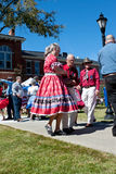 Senior Citizen Couple Square Dances At Outdoor Event Royalty Free Stock Photography