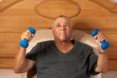 Senior citizen with dumbbells Stock Photo