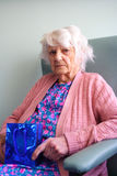 Senior citizen with gift stock photography