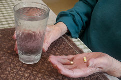 Senior Citizen Holding Medication Stock Photo