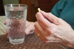 Senior Citizen Holding Medication Royalty Free Stock Photography