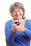 Senior citizen with homemade jam stock photography