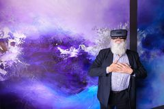 Senior citizen immersed in virtual reality with help of special. Elderly man in VR glasses outside imagination felt virtual reality and enjoys seen and new Royalty Free Stock Images
