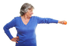 Senior citizen lifting dumbbell Stock Image