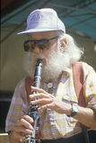 A senior citizen playing the clarinet Royalty Free Stock Photography