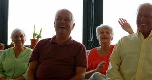 Senior citizen practicing laughter yoga