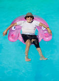 Senior citizen relaxing Stock Images