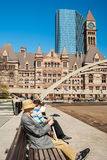 Senior citizen resting in front of old city Hall in Toronto Stock Photo