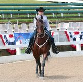 A Senior Citizen Rides A Horse At The Germantown C. A Senior Female Jockey Rides A Horse In The Annual Germantown Charity Horse Show in Memphis, Tennessee.The Stock Image