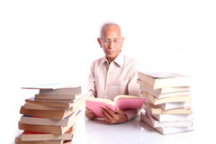 Senior citizen studying books Royalty Free Stock Photo