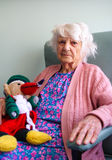 Senior citizen with toy royalty free stock images