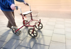 Senior citizen with walking frame Royalty Free Stock Images