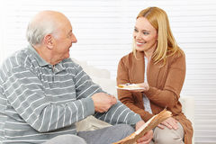 Senior citizen and woman eating Royalty Free Stock Images