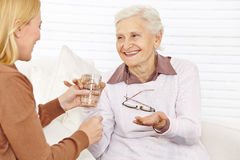 Senior citizen woman taking medical Royalty Free Stock Image