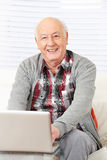 Senior citizen working with laptop Royalty Free Stock Photography