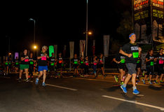Senior citizens amongst younger runners Stock Images