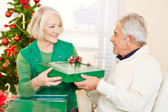Senior citizens celebrating christmas with gifts Royalty Free Stock Image