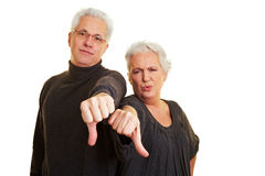 Senior citizens holding thumbs down Stock Image