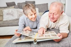 Senior citizens with photo album. Looking at photos as reminder Stock Photos