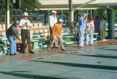Senior citizens playing shuffleboard, stock images