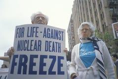 Senior citizens protesting nuclear warfare, Stock Photography