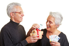 Senior citizens saving money Stock Photography