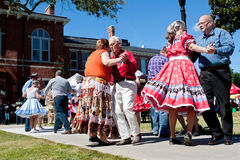 Senior Citizens Square Dance At Outdoor Event royalty free stock image