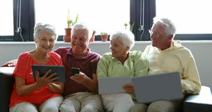 Senior citizens using digital tablet, mobile phone and laptop stock video