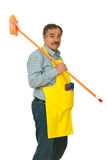 Senior cleaning man carrying broom Royalty Free Stock Photography