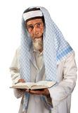 Senior cleric. A senior cleric is portrayed with a book in his hands stock photos