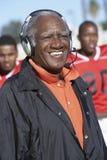 Senior Coach Wearing Headphones Stock Photography